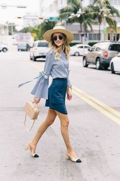 Blue bell sleeve top and denim skirt, chanel pumps and beige bag