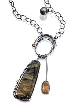 Copper and green colors shimmer in this spectacular labradorite and golden moonstone necklace. http://www.sydneylynch.com/project/long-labradorite-ring-necklace-wholesale-2/