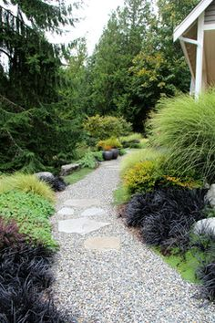 I like the groupings of stone in among the gravel path; Suhr-Brown, Bainbridge Island, WA contemporary-landscape