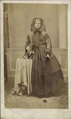 1860s widow with her dog.