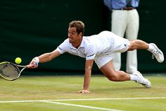 Richard Gasquet dives for a forehand on No.2 Court
