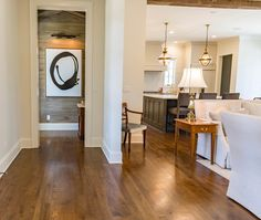 """There is nothing noble in being superior to your fellow man; true nobility is being superior to your former self."" - Ernest Hemingway American novelist Our Reclaimed White Oak flooring Pecky Cypress Skins and an Original Patina Beam peeking in from the ceiling #hardwoodfloors #paneling Commercial Interior Design, Commercial Interiors, Oak Flooring, Hardwood Floors, Reclaimed Wood Paneling, Pecky Cypress, White Oak Floors, Ernest Hemingway, Ceiling"