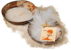 Bring an Island vibe to the air with these coconut shell candle favors. Each real coconut shell candle comes wrapped with white tulle and is accented with a real dried starfish. Simply add a personalized gift tag for a themed favor that your guests are sure to enjoy.   #CoconutShellCandleHolders #IslandVibeWeddingFavors #TropicalWeddingFavors