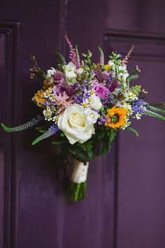 "Lovely wedding bouquet featuring a sunflower alongside roses and other wildflower type blooms. <a href=""http://nickifelthamphotography.com"" rel=""nofollow"" target=""_blank"">nickifelthamphoto...</a>"