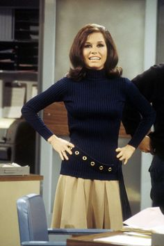 As Mary Richards, Mary Tyler Moore embodied the original working girl, with a wardrobe of pleated mini skirts, shift dresses and pantsuits to match—don't forget the elegantly-tied silk scarf to complete the look.