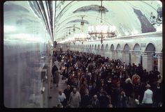 In the Moscow metro in 1969. Crowds of people head to the next subway train.
