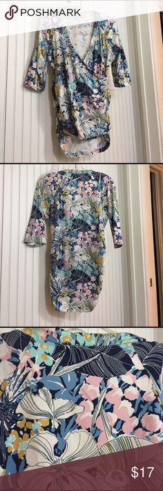 CAbi Faux Wrap Top CAbi  Faux Wrap Top with Crossover neckline and Ruching on sides, Floral Leafy Print. Good used condition from smoke free home. CAbi Tops Tees - Short Sleeve