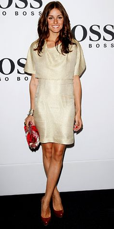 Olivia Palermo added a colorful clutch and platform pumps to an understated ivory dress