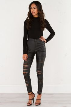 Front View of AMMO Slash Wax Leggings With Shredded Detail at Legs in Black