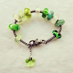 My first example of adding clip-on charms to your charm bracelet. Gorgeous Greens! #trollbeads #trollbeadsuk #trollbeadsusa #trollbeadsroma #trollbeadsitalia #charm #charms #swarovski #crystal #green #sparkle #bracelet #bracelets #beads #silver #white #jewelry #jewellery #accessories #fashion