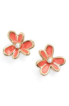 Springing into the season with these playful and cute stud earrings by Kate Spade. Freshly blossomed flowers, complete with sparkling crystal centers and glossy enamel-filled petals in coral add a splash of color to any ensemble.