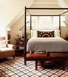 cozy attic bedroom with four poster wood bed