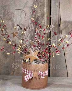 rustic can with pip berries