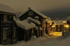 Little wooden village in Norway: Roros, in a winter night. The modern-day inhabitants of Røros still work and live in the characteristic and century buildings which have led to its designation as a UNESCO World Heritage Site in Lofoten, Places Around The World, The Places Youll Go, Places To Go, Around The Worlds, Lillehammer, Beautiful World, Beautiful Places, Beautiful Norway