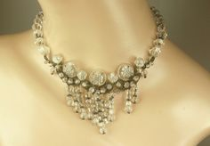 Intaglio crystal floral bead and silver necklace from the 1920s