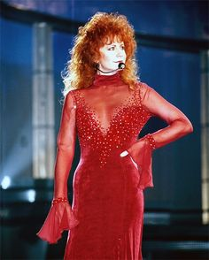 Reba McEntire in that red dress that was somehow really controversial in the country music world in 1993