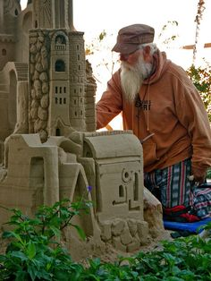 Of course the sand castle is nice but it was man that caught my eye...an original beach bum?