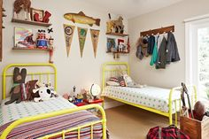 Love the contrast of the almost-neon modern yellow beds in this retro-styled shared boys' room.
