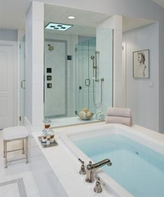 This award winning spacious bathroom uses cool tones, polished finishes and decadent accessories to create a calming oasis. Photo by Beth Singer. James Douglas Interiors, LLC Jimmy Angell - Birmingham, MI