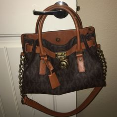 Michael Kors Signature Brown Hamilton This is a used Michael Kors Hamilton with the Brown signature print. It shows normal signs of wear as you can see in the pictures. There are some pen marks on the inside cloth lining of the bag and some natural wear to the leather on the outside. Other than that, it's in excellent condition. I love this bag  and have gotten such great use out of it as well as lots of compliments and I know you will too :) Michael Kors Bags Shoulder Bags
