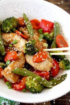 This easy Chicken and Vegetables Stir Fry  is healthy, light, full of great Asian flavors and made in one sheet pan for easy clean up! The perfect quick meal for busy weeknights. Tender pieces of chicken, carrots, red bell peppers, zucchini and sugar snap peas are cooked in a tasty and easy to make stir fry sauce.