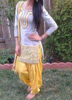 Pink grey suit- get the beautiful suit made Design Studio… Indian Designer Suits, Indian Suits, Indian Attire, Indian Dresses, Indian Wear, Punjabi Salwar Suits, Punjabi Dress, Patiala Salwar, Anarkali Suits
