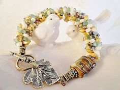 Magatuma Drops And Lampwork Bracelet, Kumihimo, Antique Brass Leaf Toggle, Sea Green Glass, Red Lined Topaz, Creamy White, Gold Matte, OOAK