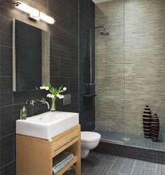 Modern & trendy bathroom in dark colors always gives us a sense of depth.