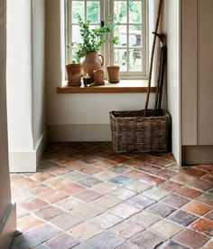 Antique burgundy terracotta tiles from Artisans of Devizes. Rustic tiles look are a great welcome to a country home. Porch Flooring, Brick Flooring, Kitchen Flooring, Rustic Tile Flooring, Stone Kitchen Floor, Brick Tile Floor, Rustic Floors, Flooring Ideas, Tiled Hallway