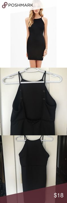 Black dress New with tags too small on me.  Got as a gift.  No trades or modeling please!  Halter open back style with adjustable straps. Forever 21 Dresses Mini