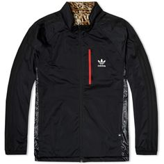 A classic piece of outerwear from Adidas originals, the Reversible Windbreaker is constructed with a 100% polyester shell and graphic print lining, allowing it to be reversed out for a bolder look. Equipped with a high stance collar, zipped chest pocket and two lower pockets, it is finished off with a woven logo tab. 100% Polyester Reversible High Stance Collar Zip Closure Chest Pocket Woven Logo Tab Style Code: S27498