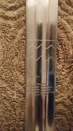 Vavasour arms on modern replica sword blade. Blazon - Or, a fess dancetty sable.