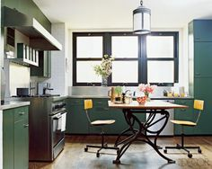 peacock (nate berkus' kitchen - original metal st. charles cabinets, desk-like table, chairs on castors...)