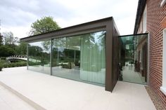 Glass extension using sliding glass doors and structural glass | Shenfield Mill | IQ Glass |