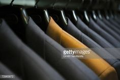 Stock Photo : Row of hanging suits in wardrobe