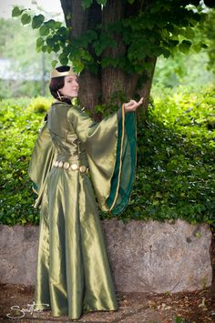 From the movie, Brave - Beautiful Adult Queen Elinor Costume by LakeFairy on Etsy, Like the ribboning on the chiffon undersleeve.
