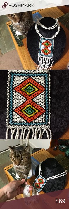 Original Vintage Native American Regalia Necklace! Beaded work of art approx. 2.5 feet long when worn on neck or 3.0 feet long when hanging. Perfect gift or to be worn on special occasions or for ceremony. Primary colors are orange, light blue, thin black border, set in white and white streaming strands with blue & black tips. Perfect kitty is not included  original work of art Jewelry Necklaces