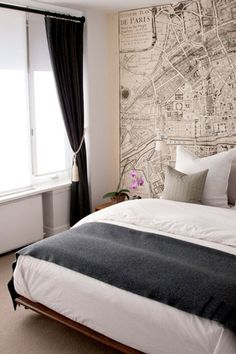 I love this, it reminds me of a hotel I stayed in while visiting in Paris...and not just because the map on the wall is of Paris.  I would definitely do this in a bedroom with lots of natural light or track/spot lighting.