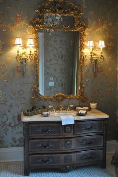 beautiful powder room with amazing marble top chest turned into basin.
