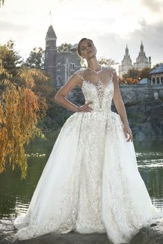 Ysa Makino Bridal Collection - Beautiful Designer Wedding Dresses - An illusion neckline wedding dress in princess ball gown silhouette with gemstone embellishment and appliques on the bodice cascading to the skirt. Neckline with deep-v and sheer back with gemstones and appliques.