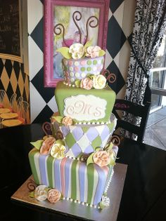 Green purple topsy turvy wedding by Designer Cakes By April, via Flickr