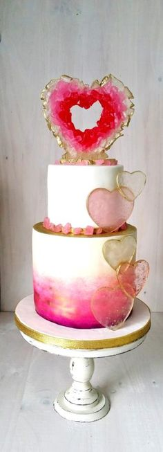 "As if the geode iced wedding cake trend wasn't enough, how's about some gorgeous heart-shaped sweet adornments? They look like lollipops without the sticks! ""Geode Hearth Cake"" - Cake by Sophia Fox"