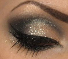 Glitter eyeshadow with a cateye liner.