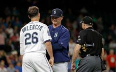 June 8: Mariners manager Scott Servais, center, gets between Danny Valencia and umpire Dan Iassogna after Valencia had words with him.