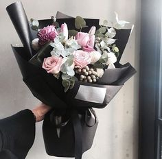 What a stunning contrast the black is to these gorgeous flowers! Lucy's florist will help with anniversary ideas!