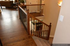 open basement stairs. Just off the entry in Saint Aubyn Homes Truman are stairs to  basement level Open railings and cast iron bannisters standar open stairway down ranch home Google Search