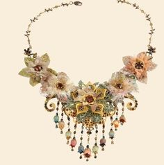 Stunning Collection from Michal Negrin, beautiful necklace on a brass chain Design with flowers in a vintage style covered in Swarovski Crystal and hanging flowers. This unique collection is truly stunning.