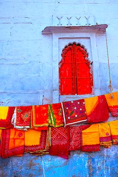 window and scarves, beautiful red, orange, yellow