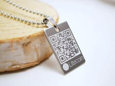 This Stainless Steel Rectangular Pendant has a snap on Stainless Steel bail. They also  custom engrave.. https://allthingsdecentral.com/collections/litecoin/products/personalized-litecoin-wallet-necklace