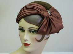 1950s Schiaparelli satin hat. Gathered satin attached to edge of hat base.